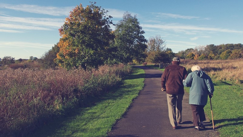 older couple walking in the countryside