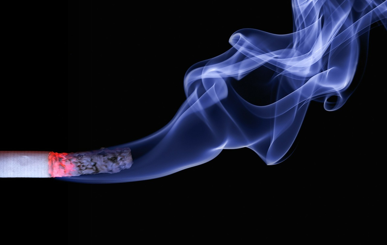 glowing cigarette wth smoke