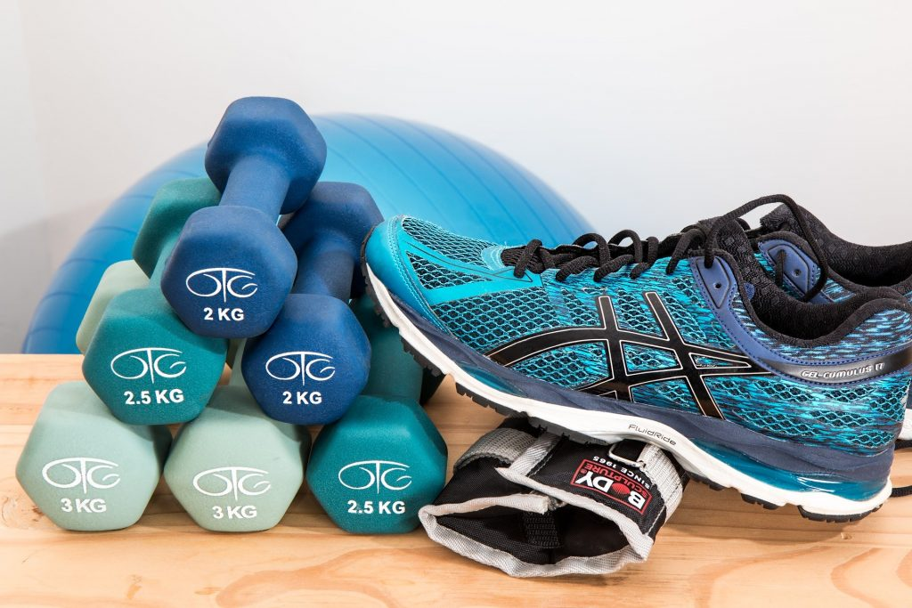 the Best Exercise Equipment For Seniors - exercise ball, dumbbells and walking shoes